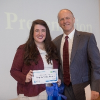 3MT People's Choice winner Chelse Hawkins with the dean of the graduate school